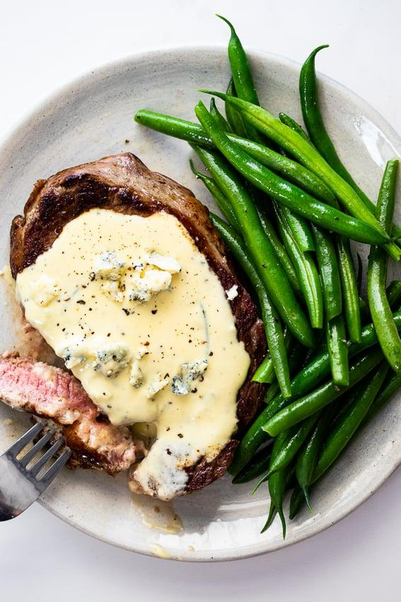 """<p>You can't go wrong with a nicely cooked steak, potatoes, and green beans. Plus, with the addition of the creamy gorgonzola sauce, you'll definitely be going back for seconds.</p> <p><strong>Get the recipe:</strong> <a href=""""http://simply-delicious-food.com/steak-with-gorgonzola-sauce/"""" target=""""_blank"""" class=""""ga-track"""" data-ga-category=""""Related"""" data-ga-label=""""http://simply-delicious-food.com/steak-with-gorgonzola-sauce/"""" data-ga-action=""""In-Line Links"""">steak with gorgonzola sauce</a></p>"""
