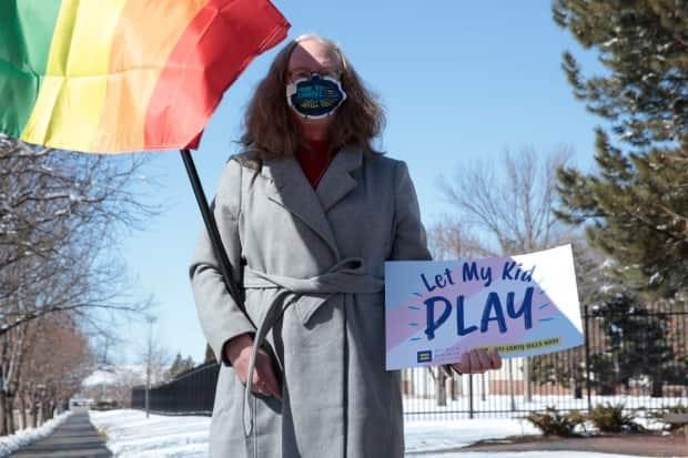 A woman demonstrates against a proposed ban on transgender girls and women from female sports leagues in South Dakota in March. Republican lawmakers in several U.S. states have introduced legislature related to transgender issues. (Stephen Groves/The Associated Press - image credit)