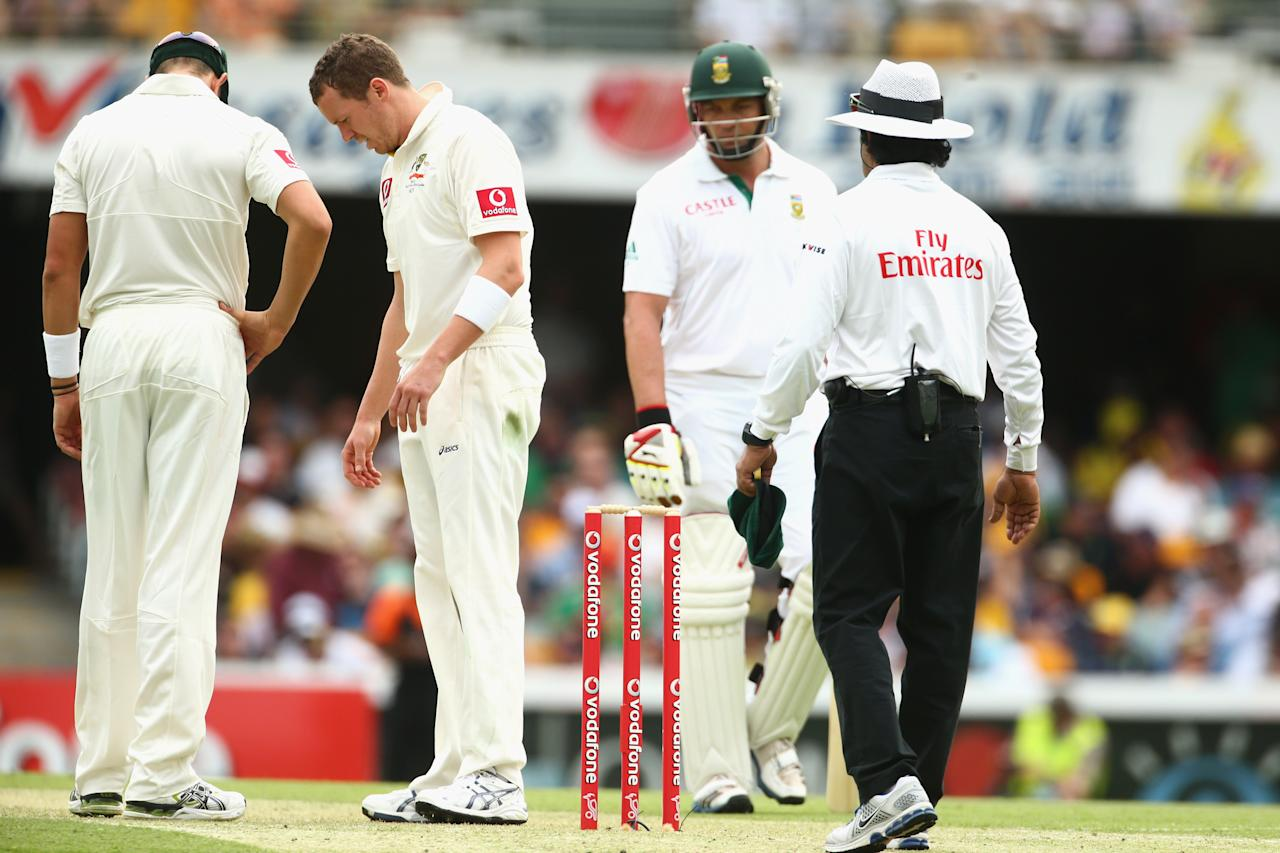 BRISBANE, AUSTRALIA - NOVEMBER 09:  Peter Siddle of Australia looks at his foot marks after taking the wicket of Jacques Kallis of South Africa only to have it over rules due to a no-ball during day one of the First Test match between Australia and South Africa at The Gabba on November 9, 2012 in Brisbane, Australia.  (Photo by Mark Kolbe/Getty Images)