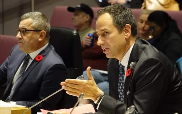 Ottawa's city manager Steve Kanellakos, left, made more than any municipal employee in 2020. OC Transpo boss John Manconi, who made more than $295,000, came in lower down the list this year.