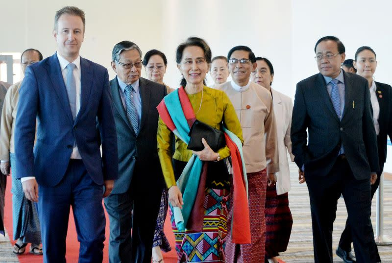 Myanmar's State Counsellor Aung San Suu Kyi departs from Naypyidaw International Airport ahead of her appearance at the International Court of Justice to defend the country against charges of genocide of its Rohingya Muslim minority