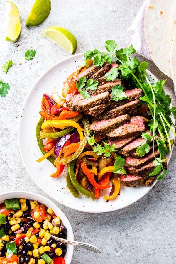 """<p>These steak fajitas by<a href=""""https://www.savorynothings.com/perfect-steak-fajitas/"""" rel=""""nofollow noopener"""" target=""""_blank"""" data-ylk=""""slk:Savory Nothings"""" class=""""link rapid-noclick-resp""""> Savory Nothings</a> are simple but oh so delicious. This recipe calls for flank steak, and it's ready in only 30 minutes, making it a quick weeknight meal that's high in nutritional value. Stuff into tortillas along with avocado and some veggies, and you're all set. A pro tip—cook against the grain for a perfectly tender steak.</p>"""