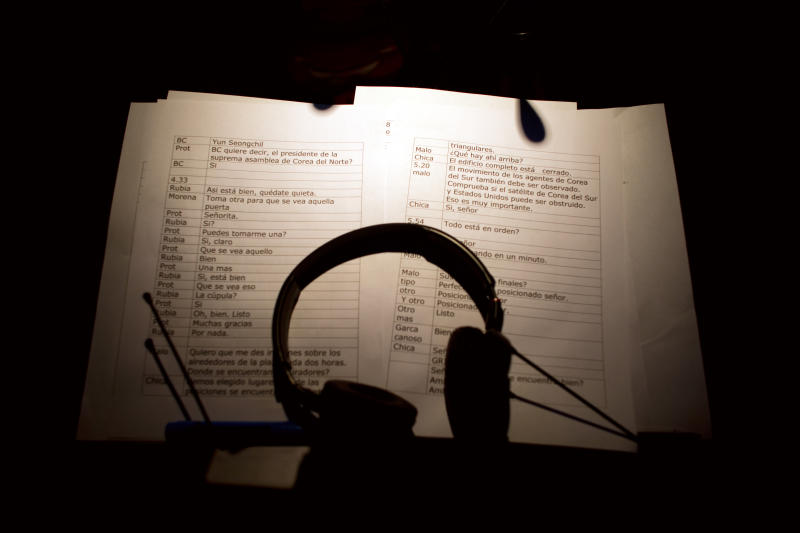 "Headsets rest over the script of a Korean action movie at a dubbing studio in Buenos Aires, Argentina, Friday, Aug. 23, 2013. In a bid to recover part of Argentina's lost cultural heritage, create more jobs and stir up nationalist pride in an election year, President Cristina Fernandez has decreed that certain broadcast TV shows must be dubbed instead into Argentina's lyrical brand of Spanish, though stipulating the language must be ""neutral"" enough for all Latin Americans to understand. The decree gives government regulators until Sept. 15 to implement the law. (AP Photo/Victor R. Caivano)"