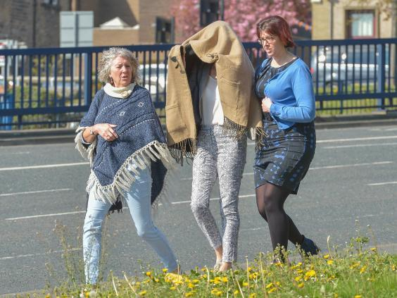 Sarah Higgins, 42, pictured centre leaving Huddersfield Magistrates' Court in April 2019, has been charged with manslaughter over the death of 10-month-old Skylar Giller in August 2017. (Alex Cousins/SWNS/file photo)