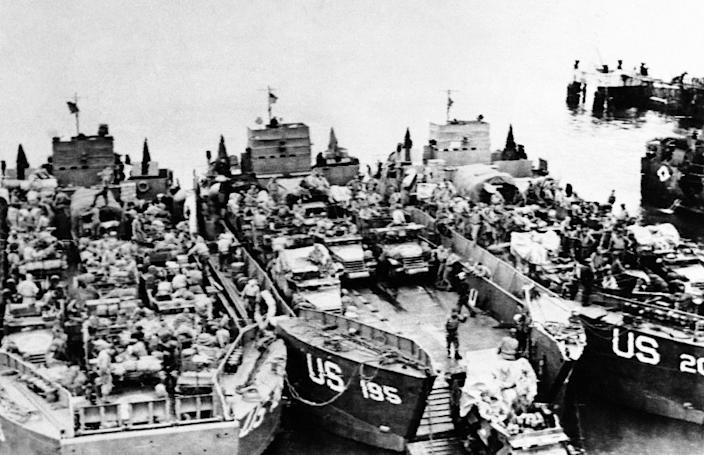 Landing craft loaded with invasion assault landing craft tanks are loaded with half tracks and other armored vehicles by American troops at an embarkation point in England on June 6, 1944, just before they set sail for the D-Day invasion of the French coast. (Photo: AP)