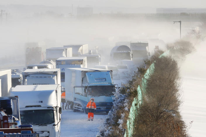 Cars are stuck on the snowy Tohoku Expressway in Osaki city, Miyagi prefecture, northern Japan, after a multiple car accident, Tuesday, Jan. 19. 2021. (Yusuke Ogata/Kyodo News via AP)
