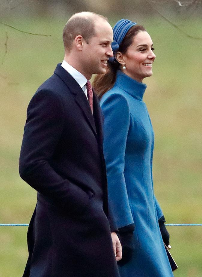 <p>The 36-year-old Duchess looked stunning in a royal blue Catherine Walker coat, which she previously wore while pregnant with Prince Louis, in February of last year. She also wore a matching headband, a polka dot dress, dark heels and a clutch. Photo: Getty </p>