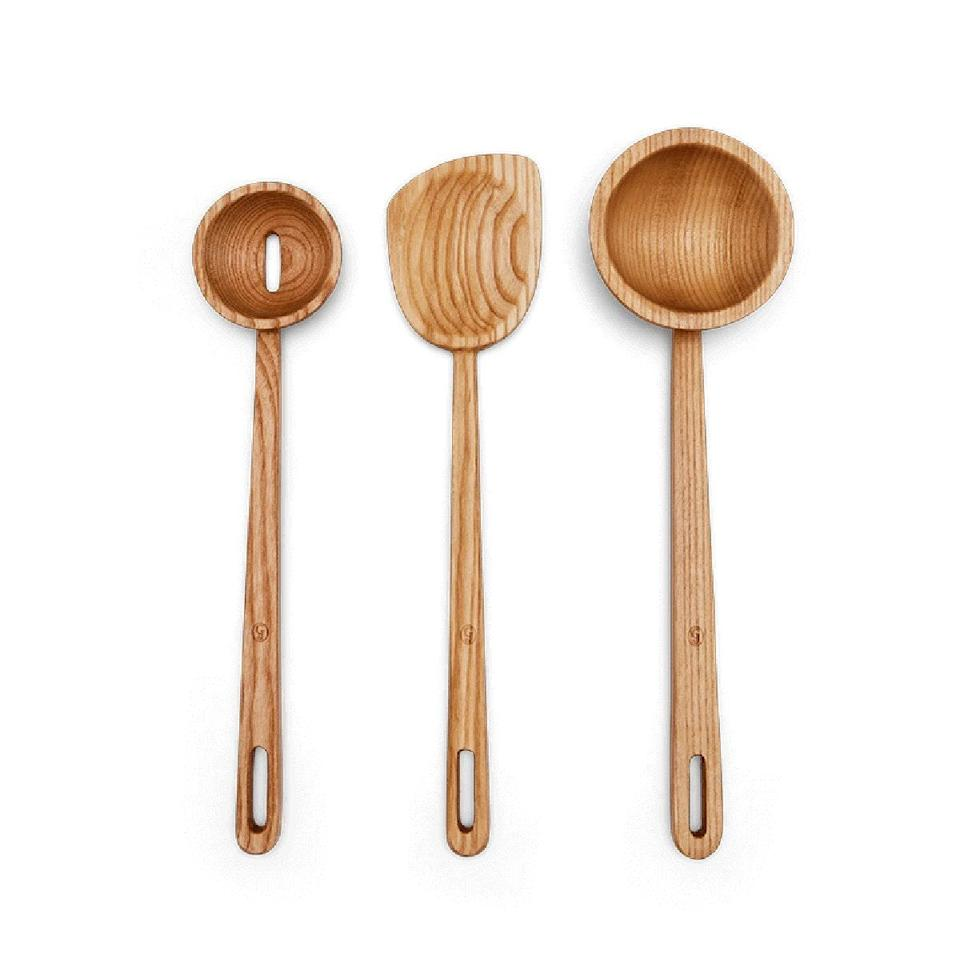 """Replace her old set of utensils with this wooden trio from Great Jones, complete with a spatula, slotted spoon, and oversized ladle for all of her culinary creations. $75, Great Jones. <a href=""""https://greatjonesgoods.com/products/whole-grain-family"""" rel=""""nofollow noopener"""" target=""""_blank"""" data-ylk=""""slk:Get it now!"""" class=""""link rapid-noclick-resp"""">Get it now!</a>"""