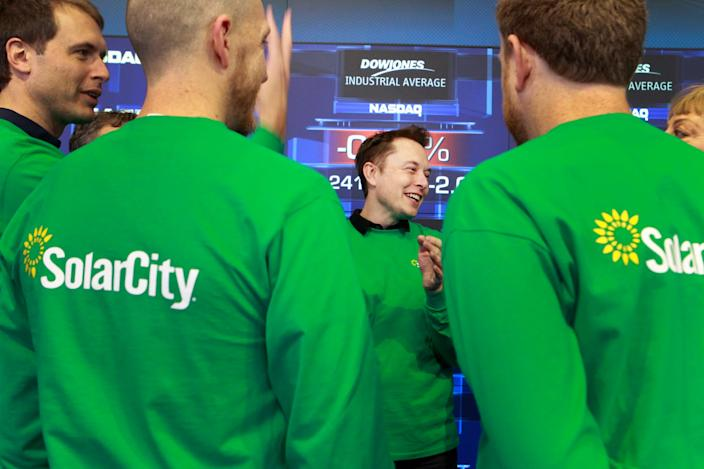 Then-SolarCity chairman Elon Musk is seen in this December 2012 photo attending the company's IPO in New York.