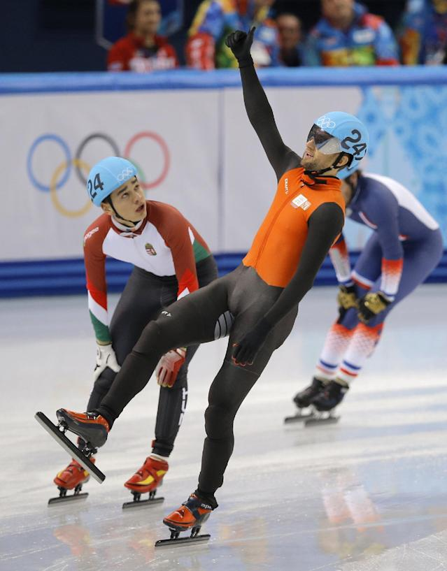 Niels Kerstholt of the Netherlands, right, gestures after crossing the finish line in a men's 1500m short track speedskating heat at the Iceberg Skating Palace during the 2014 Winter Olympics, Monday, Feb. 10, 2014, in Sochi, Russia. (AP Photo/Vadim Ghirda)