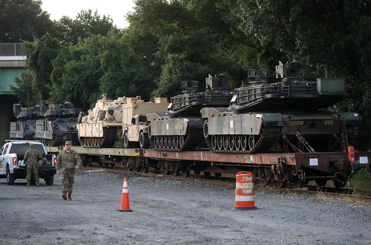 Two M1A1 Abrams tanks and other military vehicles sit on guarded rail cars at a rail yard on July 2, 2019, in Washington, DC. President Trump asked the Pentagon for military hardware, including tanks, to be displayed during the 4th of July Salute To America on the National Mall.