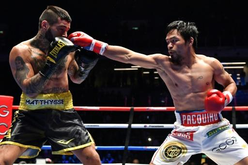 Manny Pacquiao (R) began his professional ring career as a teenager, and in 23 years has compiled a 60-7-2 win-loss-draw record with 39 knockouts
