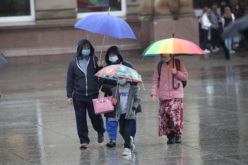 People with umbrellas in Nottingham city centre, as heavy rain is lashing parts of the UK, with the Met Office issuing warnings not seen since March. (Photo by Danny Lawson/PA Images via Getty Images)