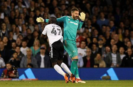 Soccer Football - Championship Play Off Semi Final Second Leg - Fulham vs Derby County - Craven Cottage, London, Britain - May 14, 2018 Fulham's Aboubakar Kamara is booked for simulation following this challenge with Derby's Scott Carson Action Images via Reuters/Tony O'Brien