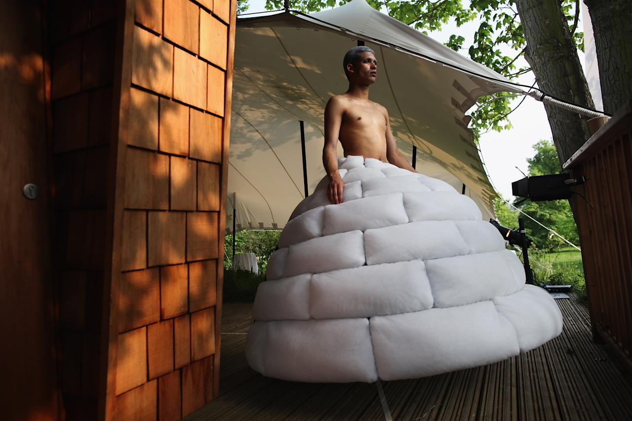 LONDON, ENGLAND - MAY 24:  A model wearing 'Igloo Dress' by English Eccentrics ahead of a fashion show and auction at WWF Pandamonium 2012, in Hyde Park on May 24, 2012 in London, England.  WWF Pandamonium 2012, hosted by artist Grayson Perry, showcased and auctioned wearable sculptures created by leading fashion designers and artists with the aim to show the breadth of work the World Wildlife Fund undertakes and to celebrate 50 years of work by the WWF.  (Photo by Dan Kitwood/Getty Images)