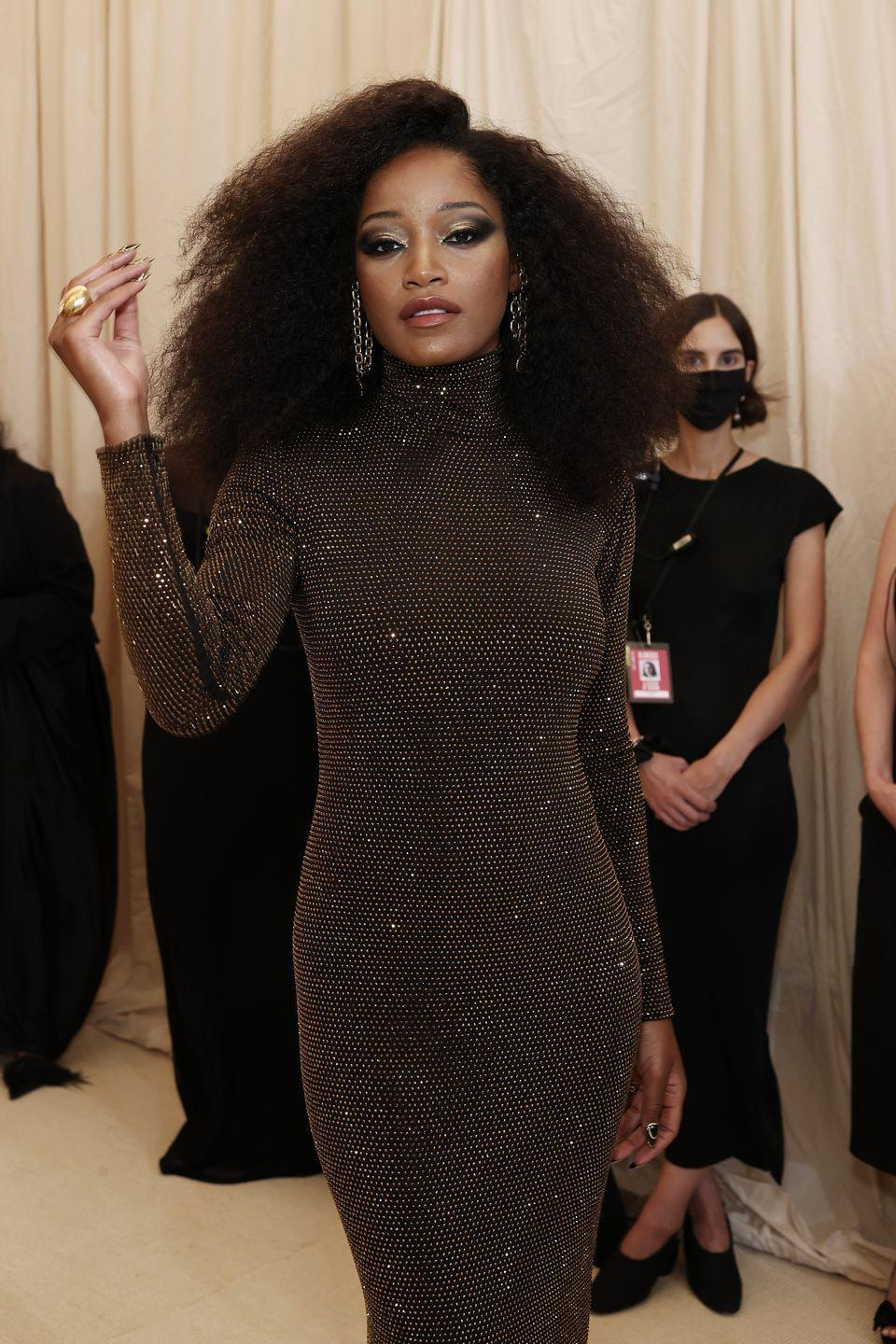 <p>Channeling Diana Ross with a sparkling Sergio Hudson gown, Keke Palmer stepped out with a blown-out afro that hits just under her shoulder bone.</p>