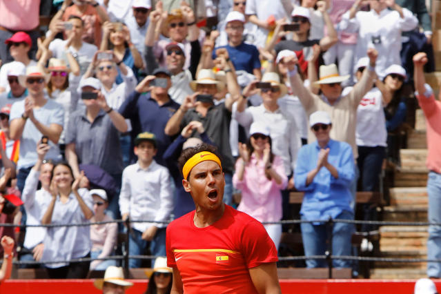 FILE - In this Sunday, April 8, 2018 file photo Spain's Rafael Nadal reacts after defeating Germany's Alexander Zverev 6-1, 6-4, 6-4 during a World Group Quarter final Davis Cup tennis match between Spain and Germany at the bullring in Valencia, Spain. For now, Nadal doesnt see himself skipping Wimbledon the way Roger Federer has the French Open. The two veterans are back at the top of world tennis, with Nadal needing to win this weeks Monte Carlo Masters to avoid losing his top ranking once again to Federer in their seemingly eternal battle for tennis supremacy. (AP Photo/Alberto Saiz, File)