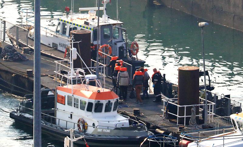 A group of people thought to be migrants are brought to shore at the Port of Dover