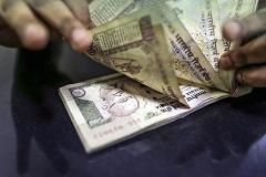 September's best performing currency was... Rupee??