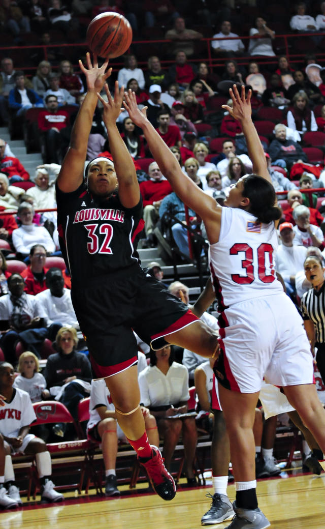 Louisville forward Emmonnie Henderson (32) shoots the ball against Western Kentucky forward Chastity Gooch (30) during an NCAA college basketball game Wednesday, Nov. 27, 2013, at E.A. Diddle Arena in Bowling Green, Ky. (AP Photo/Daily News, Miranda Pederson)