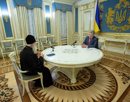 Ukraine's President Petro Poroshenko (R) meets with Patriarch Filaret, head of the Ukrainian Orthodox Church of the Kiev Patriarchate, in Kiev, Ukraine October 11, 2018. Mykhailo Markiv/Ukrainian Presidential Press Service/Handout via REUTERS