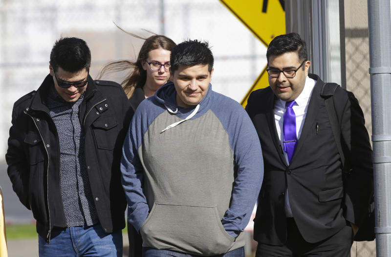 Daniel Ramirez Medina, second from right, walks out of the Northwest Detention Center in Tacoma, Wash., with his attorney, Luis Cortes, right, and his brother, left, who has not been identified by name, after Ramirez was released from federal custody, Wednesday, March 29, 2017. Ramirez had spent more than six weeks in immigration detention despite his participation in a program designed to prevent the deportation of those brought to the U.S. illegally as children. (AP Photo/Ted S. Warren)