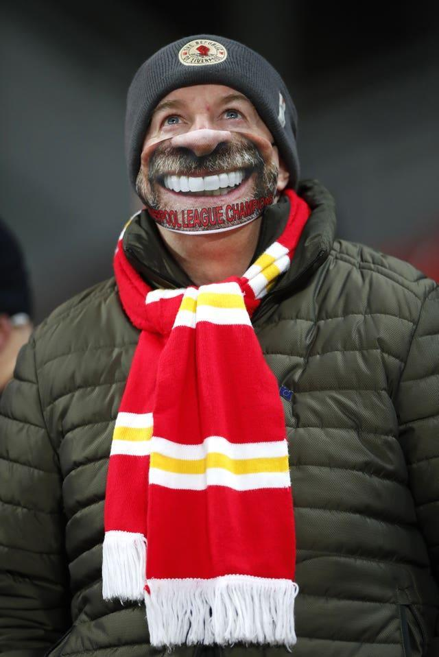 A lucky Liverpool fan sports a novelty face mask after being among the select few to acquire a ticket to attend the fixture against Wolves in early December. Almost nine months after the last Premier League game was played in front of spectators, the Reds gave their 2,000 followers in attendance plenty to smile about by running out resounding 4-0 winners over Wolves