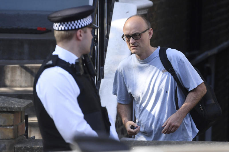Dominic Cummings, top aide to British Prime Minister Boris Johnson, leaves his home in north London, Wednesday, May 27, 2020. The British government faced accusations of hypocrisy after the revelation that Cummings traveled more than 250 miles (400 kms) to his parents' house during a nationwide lockdown while he was showing coronavirus symptoms. (Kirsty O'Connor/PA via AP)