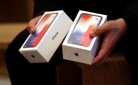 usbA man holds two boxes for the Apple's new iPhone X which went on sale today, at the Apple Store in Regents Street in London