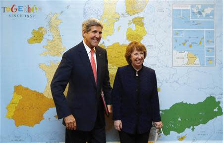 U.S. Secretary of State John Kerry (L) is pictured with European Union foreign policy chief Catherine Ashton before their meeting with Iranian Foreign Minister Mohammad Javad Zarif (not pictured) in Geneva, November 8, 2013. REUTERS/Jason Reed