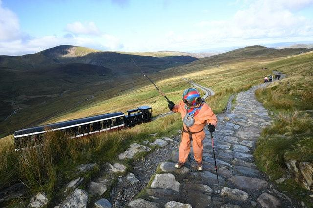 Lloyd Scott climbs Mount Snowdon wearing a diving suit