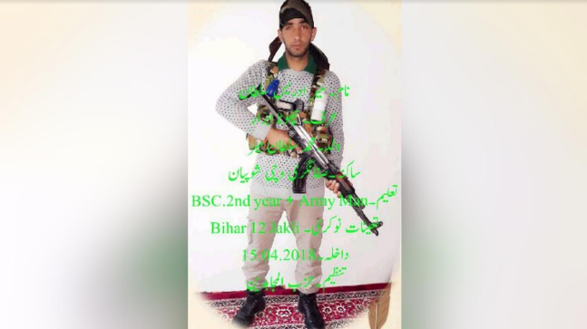 A picture showing him holding an AK-47 rifle has gone viral.