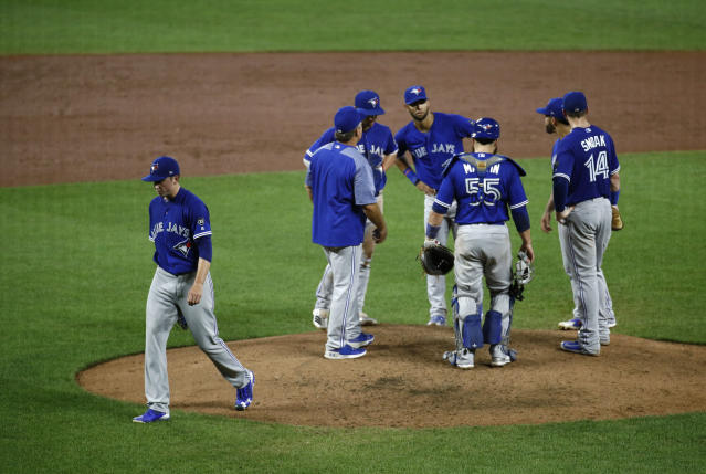Toronto Blue Jays starting pitcher Ryan Borucki, left, walks off the field after being relieved in the fifth inning of a baseball game against the Baltimore Orioles, Wednesday, Aug. 29, 2018, in Baltimore. Borucki gave up a grand slam to Baltimore in the fifth. (AP Photo/Patrick Semansky)