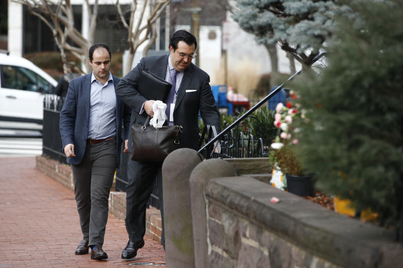 In this Jan. 28, 2020 photo, Jordan Sekulow, right, the executive director of American Center for Law and Justice, opens a gate as he arrives at a property on Capitol Hill in Washington. (AP Photo/Patrick Semansky)