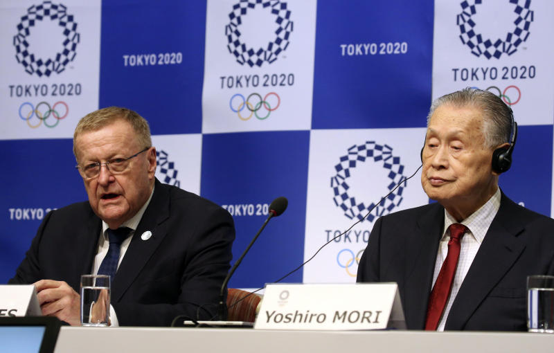 """Head of the IOC inspection team John Coates, left, speaks as Tokyo 2020 President Yoshiro Mori listens during a press conference in Tokyo, Wednesday, Dec. 5, 2018. IOC President Thomas Bach has said no city has been """"as ready as Tokyo"""" to hold the Olympics. Bach and other International Olympic Committee are calling Tokyo the best prepared in recent memory with the games just 20 months away. (AP Photo/Koji Sasahara)"""