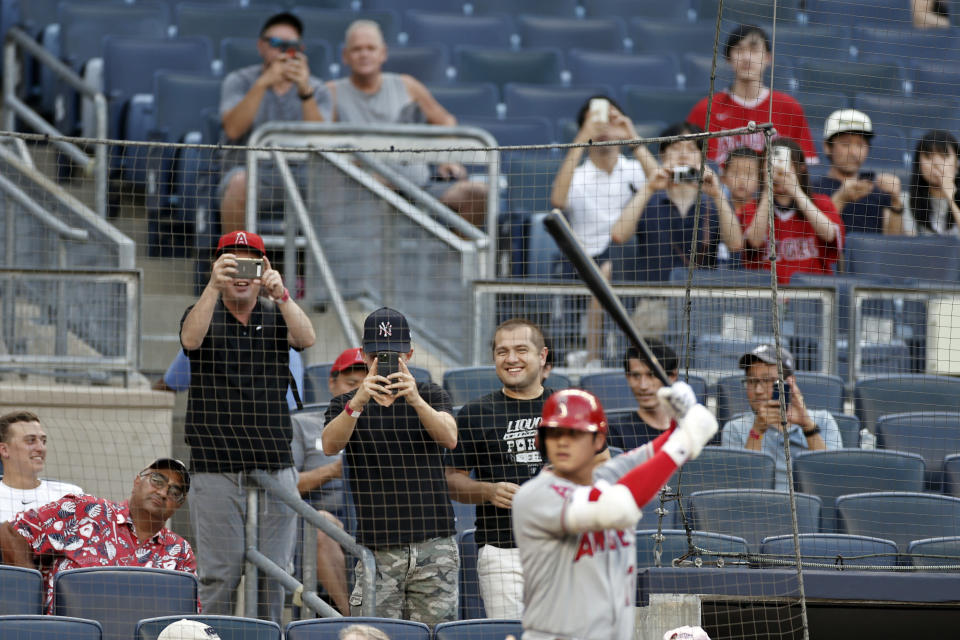 Fans take photos of Los Angeles Angels' Shohei Ohtani during the first inning of the team's baseball game against the New York Yankees on Wednesday, June 30, 2021, in New York. (AP Photo/Adam Hunger)