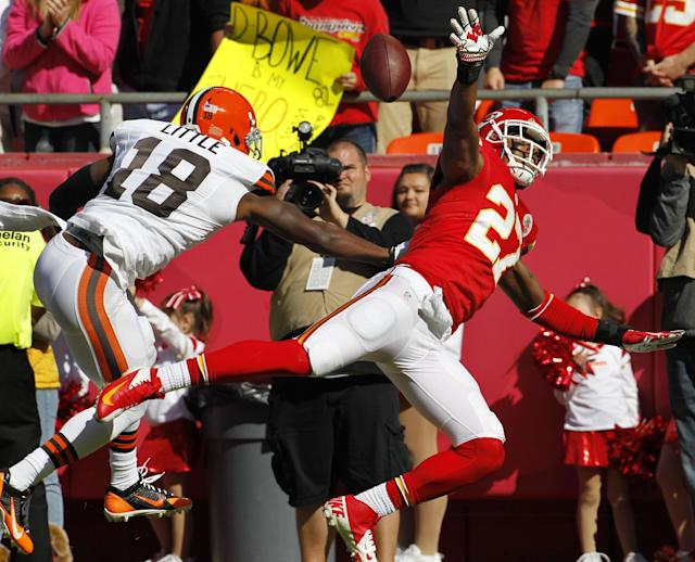 Cleveland Browns wide receiver Greg Little (18) knocks the ball away from Kansas City Chiefs cornerback Sean Smith (27) to avoid an interception during the first half of an NFL football game in Kansas City, Mo., Sunday, Oct. 27, 2013. (AP Photo/Colin E. Braley)