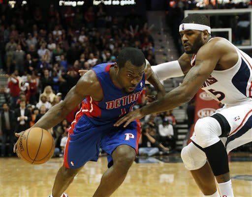 Detroit Pistons point guard Will Bynum, left, drives against Atlanta Hawks small forward Josh Smith (5) in the second half of an NBA basketball game on Wednesday, Dec. 26, 2012, in Atlanta. Atlanta won 126-119 in double overtime. (AP Photo/John Bazemore)