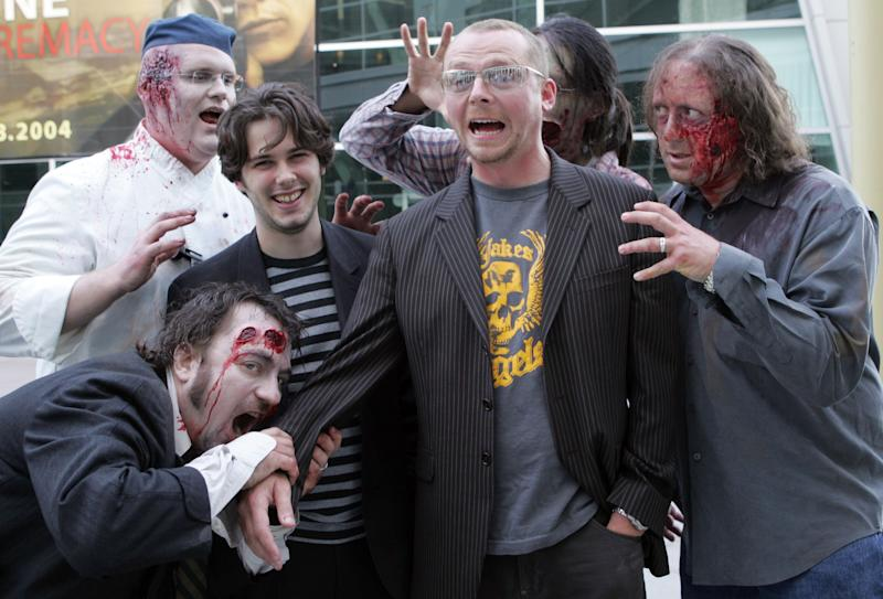 Edgar Wright, writer and director and Simon Pegg, co-writer with zombies *exclusive* ***Exclusive*** (Photo by Mathew Imaging/FilmMagic)