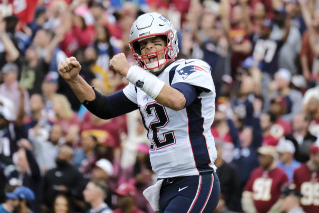 "FILE - In this Oct. 6, 2019, file photo, New England Patriots quarterback Tom Brady (12) reacts to a touchdown against the Washington Redskins during the second half of an NFL football game in Washington. Brady, the centerpiece of the New England Patriots' championship dynasty over the past two decades, appears poised to leave the only football home he has ever had. The 42-year-old six-time Super Bowl winner posted Tuesday, March 17, 2020, on social media ""my football journey will take place elsewhere."" The comments were the first to indicate the most-decorated player in NFL history would leave New England. (AP Photo/Mark Tenally, File)"