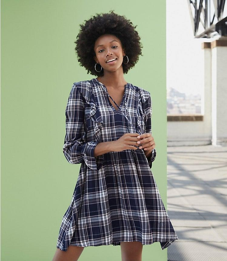 <p>Wear this <span>Loft Plaid Ruffle Swing Dress</span> ($80) in between seasons.</p>