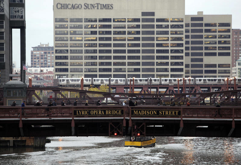 FILE - This Oct. 26, 2009 file photo shows the the Chicago Sun-Times building in Chicago. Sun-Times Media released a statement Thursday, May 30, 2013, to The Associated Press confirming it had laid off its entire full-time photography staff. (AP Photo/Kiichiro Sato, File)