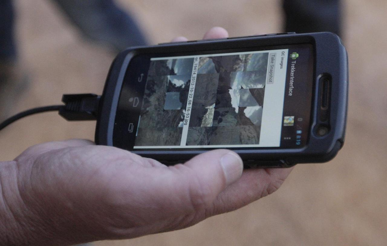 In this Monday Oct. 22, 2012, photo, Google operations manager Steve Silverman shows low-resolution images of photos gathered by the Trekker on an Android phone during a demonstration for the media along the Bright Angel Trail at the South Rim of the Grand Canyon National Park in Arizona. The search engine giant is using the Trekker, a nearly 40-pound, backpack-sized camera unit, to showcase the Grand Canyon's most popular hiking trails on the South Rim and other off-road sites. It's the latest evolution in mapping technology for the Mountain View, Calif., company, which has used a rosette of cameras to photograph thousands of cities and towns in dozens of countries for its Street View feature. (AP Photo/Rick Bowmer)