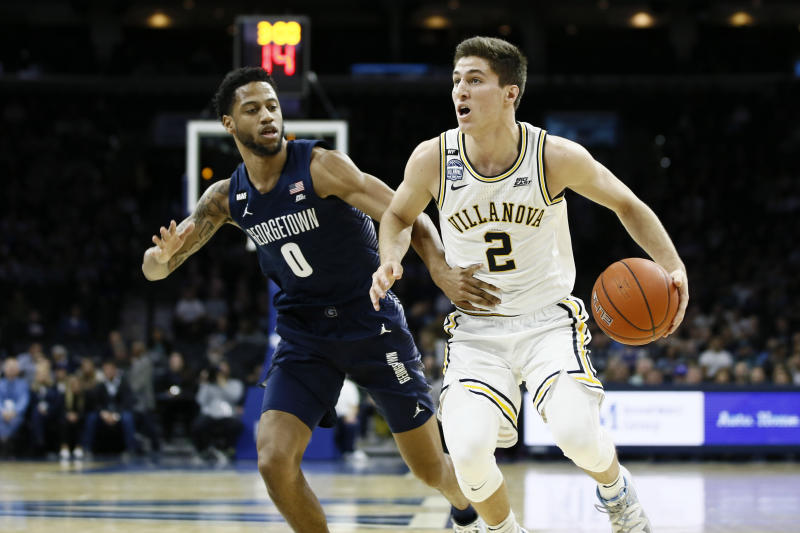 Villanova's Collin Gillespie, right, tries to dribble past Georgetown's Jahvon Blair during the first half of an NCAA college basketball game, Saturday, Jan. 11, 2020, in Philadelphia. (AP Photo/Matt Slocum)
