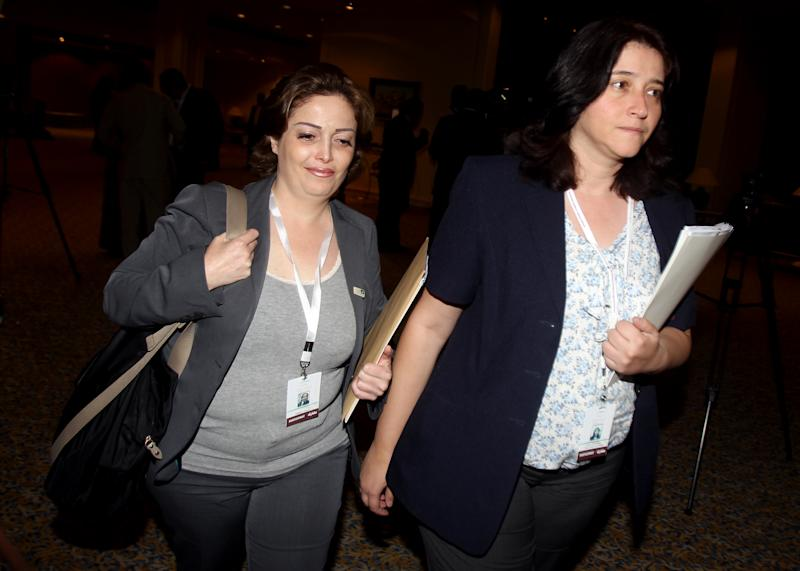 Syrian opposition members Suheir Atassi, left, and Rima Fleihan attend the meeting of the General Assembly of the Syrian National Council in Doha, Qatar, Thursday, Nov. 8, 2012. (AP Photo/Osama Faisal)