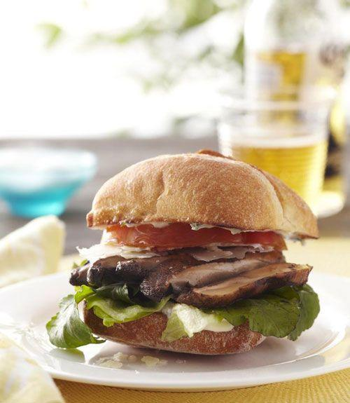 """<p>This substantial fire-seared portobello burger, slathered with basil mayo and sandwiched in a ciabatta bun, is brawny enough for beef lovers. Before grilling, brush the mushrooms with rosemary-garlic oil for a rich, robust taste.</p><p><a href=""""https://www.goodhousekeeping.com/food-recipes/a11062/plt-sandwiches-recipe-ghk0811/"""" rel=""""nofollow noopener"""" target=""""_blank"""" data-ylk=""""slk:Get the recipe for PLT Sandwich »"""" class=""""link rapid-noclick-resp""""><em>Get the recipe for PLT Sandwich »</em></a></p>"""