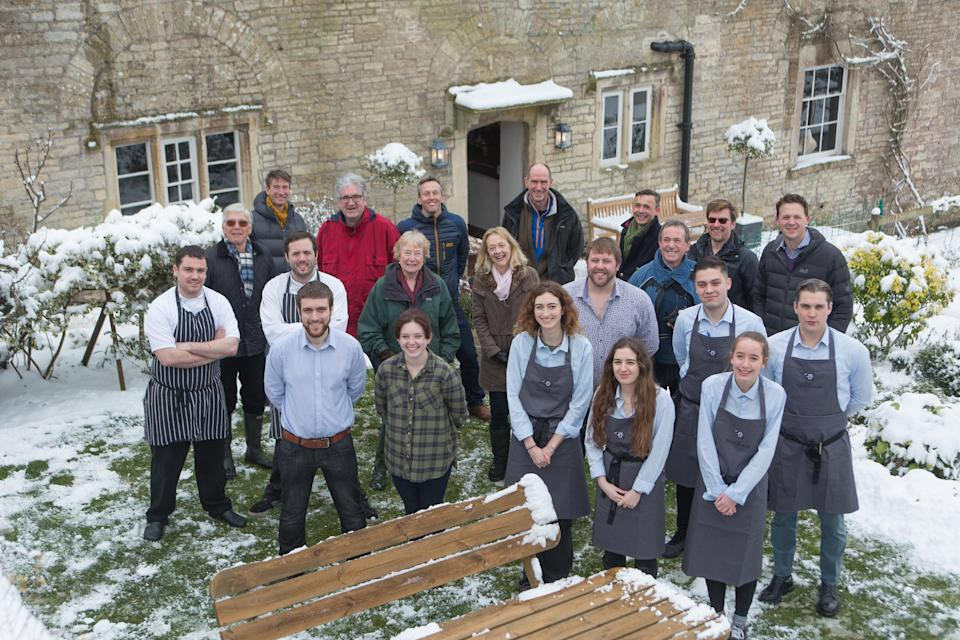 Staff and members of the group that helped save the Packhorse Inn (SWNS.com)