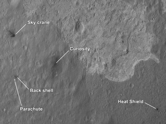 NASA's Curiosity rover and its landing sky crane, parachute and other hardware are seen by the Mars Reconnaissance Orbiter in this image released Aug. 7, 2012. Curiosity landed on Aug. 5 PDT.