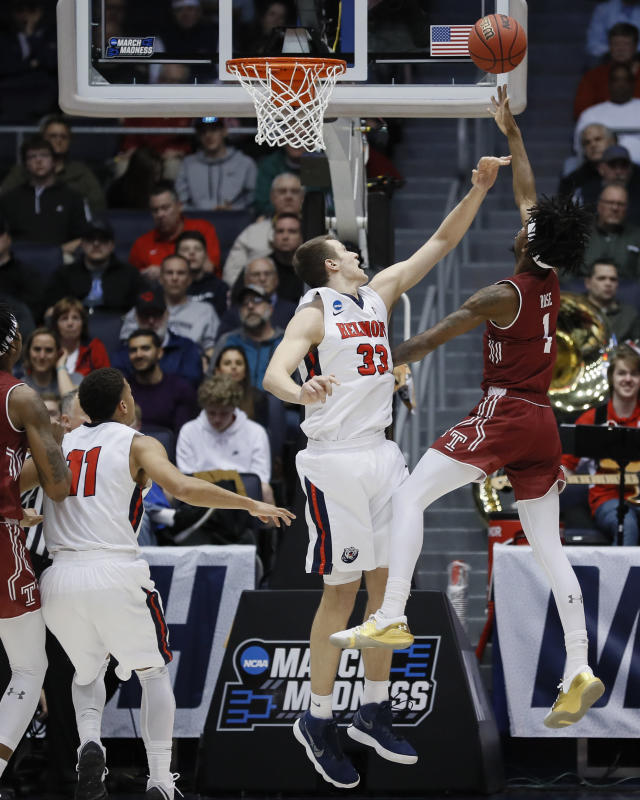 Temple's Quinton Rose (1) shoots against Belmont's Nick Muszynski (33) during the first half of a First Four game of the NCAA college basketball tournament, Tuesday, March 19, 2019, in Dayton, Ohio. (AP Photo/John Minchillo)