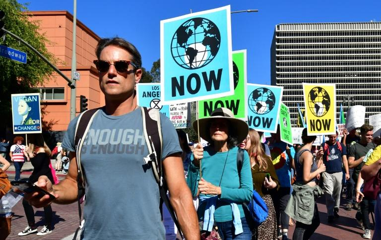 Activists march through downtown Los Angeles in November 2019 in a climate change rally addressed by teenage Swedish activist Greta Thunberg